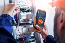 Electrician Installing Electric Cable Wires Of Fuse Switch Box.