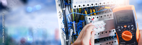 Electrician engineer installing and test electric connection wires of fuse switch box фототапет