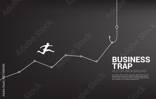 Photo Silhouette of businessman jumping higher on line graph with fishing hook