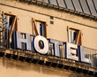 Paris: Hotel sign on the facade of old hausmannian building in central Paris - romantic French city warm sunset colors