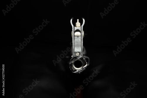 Photo The barrel of a Kalashnikov AK-47 assault rifle on a black background