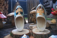 Two Pairs Of Wooden Clogs With...