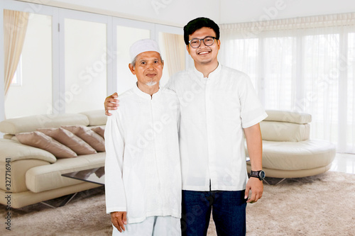 Fotomural Family photo of father and son during Eid Mubarak celebration