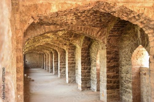 фотография Old Historical Golconda Fort Corridor in India Background stock photograph