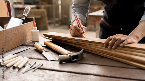 Papel de parede Carpenter working with equipment on wooden table in carpentry shop
