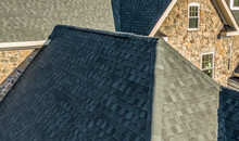 Aerial Close-up View Of A Modern Asphalt Shingle Roof With Classic Ridge, Left And Right Rake On A Newly Constructed Single Family Home In Maryland USA
