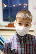 Young boy in medicial mask protection from virus