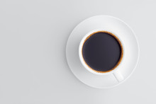 Flat Lay Coffee Cup On A Saucer Filled With Black Coffee With Froth On A Gray Background With Copy Space.