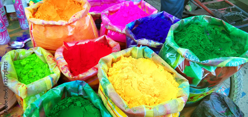 Colorful piles of powder sold on the market before Holi festival in India Canvas Print