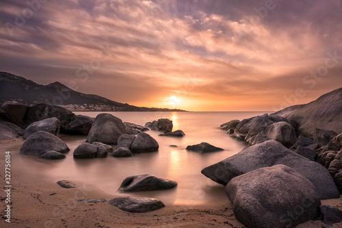 Obraz Sunset over beach and village of Algajola in Corsica - fototapety do salonu