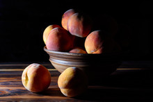 Peaches On A Plate On A Rustic...