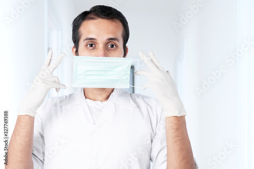 Obraz Asian doctor man in protective gloves wearing flu - fototapety do salonu