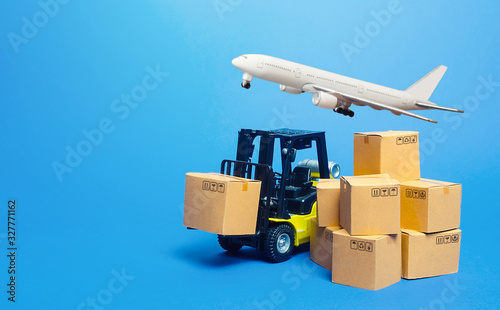 Fotografie, Tablou Forklift truck with cardboard boxes and freight plane