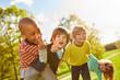 Leinwandbild Motiv Kinder im multikulturellen Kindergarten albern