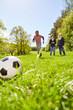 Leinwandbild Motiv Kinder beim Fußball Training im Sonnenschein
