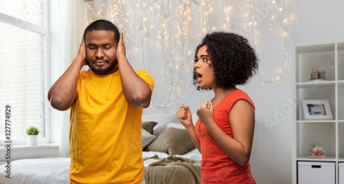 Photo relationships and people concept - unhappy african american couple having argume
