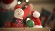 Christmas Holidays - Santa figurine with person decorating Christmas tree