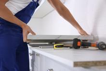Worker Installing New Countert...