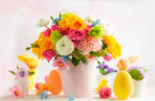 Easter Decoration With Beautiful Spring Flowers In Vase, Easter Eggs And Bunny On White Wooden Table. Easter Concept