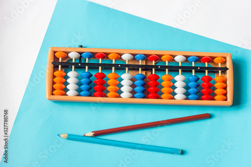 Photo Mental arithmetic and development concept, abacus and mathematical examples on a