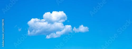 Fototapeta blue sky background with tiny clouds obraz