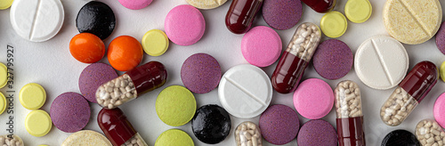 Fototapeta The medicine concept. Multicolored medicines background. Different remedy, pills, capsule, antibiotic and vitamin, panoramic banner. obraz