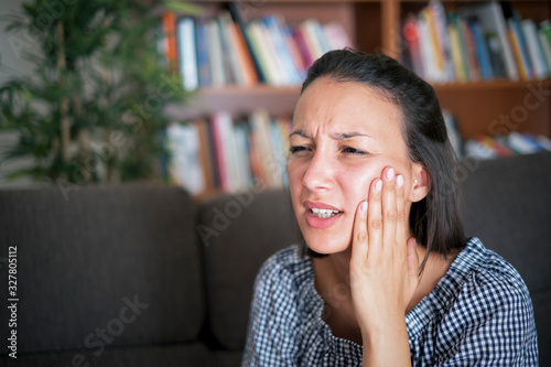 Stampa su Tela Suffering bad toothache and feeling pain in the mouth