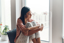 Thoughtful Young Woman In Cozy...