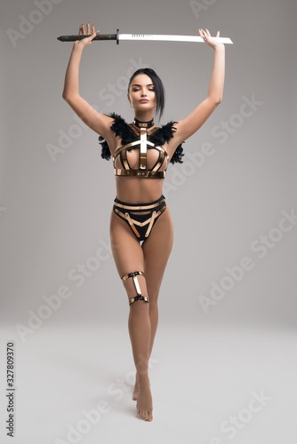 Slim female warrior in stylish metal underwear Fototapete