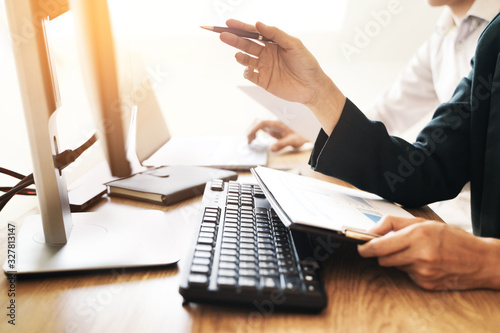 Investment concept, Investor calculating a valuation of stock market exchange Canvas Print