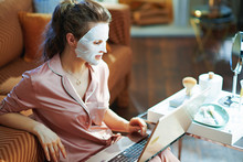 Elegant Woman With Facial Mask...