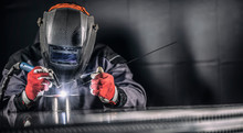 Welder Industrial Worker Welding With Argon Machine