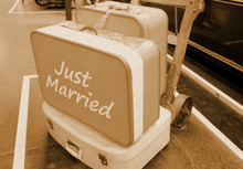 Vintage Photo Of Suitcases With Sign Just Married On The Platform Next To The Old Steam Train (locomotive)