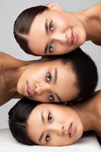 Portrait Of Multiethnic Women Looking At Camera, Gray Background, Vertical