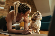 Happy Sportswoman With A Dog E...