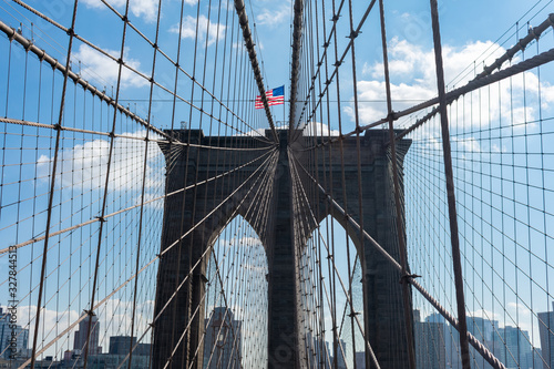 Photo Arches on the Brooklyn Bridge with an American Flag in New York City