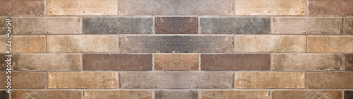 Fotografie, Obraz Brown gray natural stone tiles masonry wall texture background banner