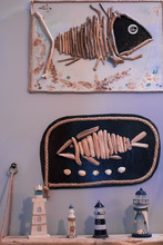 Patterns With Fish Made Of Driftwood And A Wooden Shelf With Lighthouse