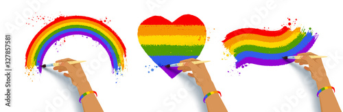 Photo Set of hands drawing LGBTQ flags colors