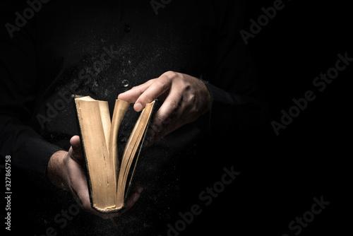 Obraz na plátne Man reads a book