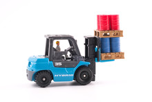 Miniature People : Engineer Driving Forklift And Lift Up Palette Which Have Four Red Drums And Four Blue Drums Isolated On White Background. Industrial And Business Concept.