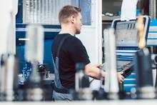 Worker In Industrial Workshop ...