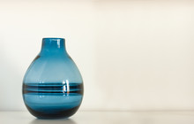 Vase On Blue Background.