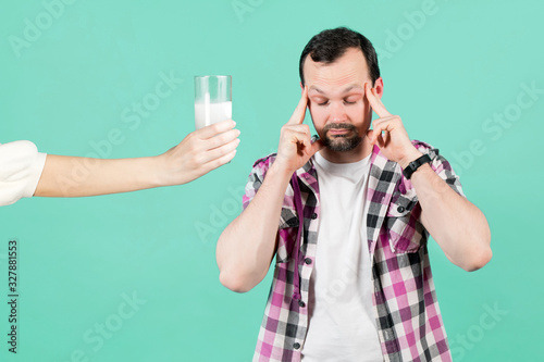Fotografie, Tablou girl offers a man with a headache a glass of water and a soluble tablet