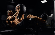Man Building Core Muscles With...