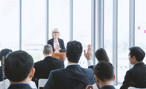 Fototapeta Beautiful of business woman is speaking on conference. Seminar of business model and inspiration concept with the audience put hand up to ask the question from topic. obraz