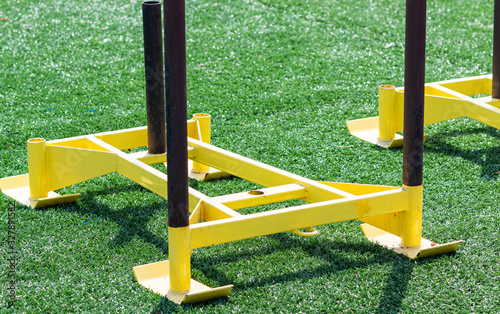 Yellow sleds for pushing wieght set up on turf field
