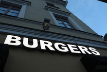 Burgers Symbol On Building Wall