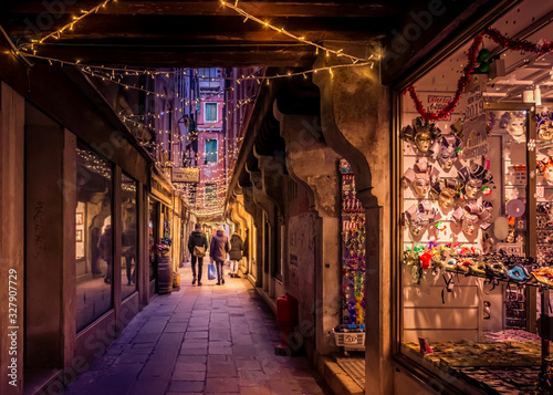 alley in venice with the warm yellow glow of christmas lights Wallpaper Mural