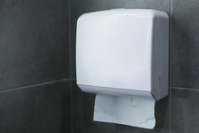 Box With Paper Towels For Drying Hands On A Gray Wall